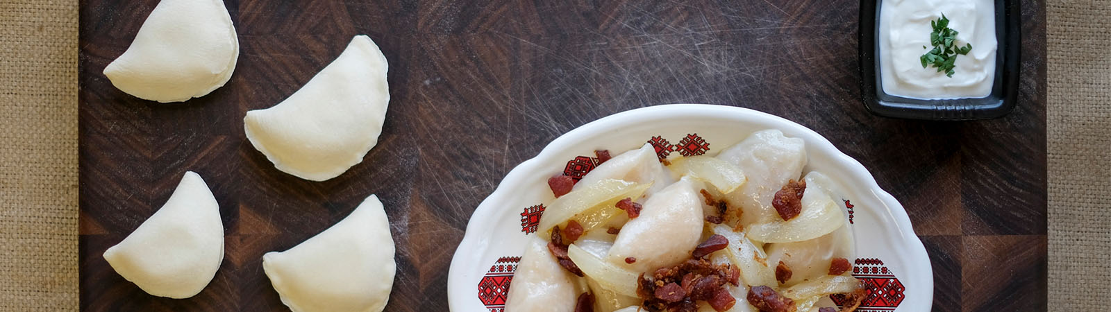 plate of perogies with bacon and onions